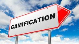 """Schild mit Aufschrift """"Gamification""""."""