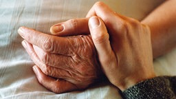 Zwei Hände.
