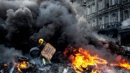 Brennende Barrikaden in Kiew.